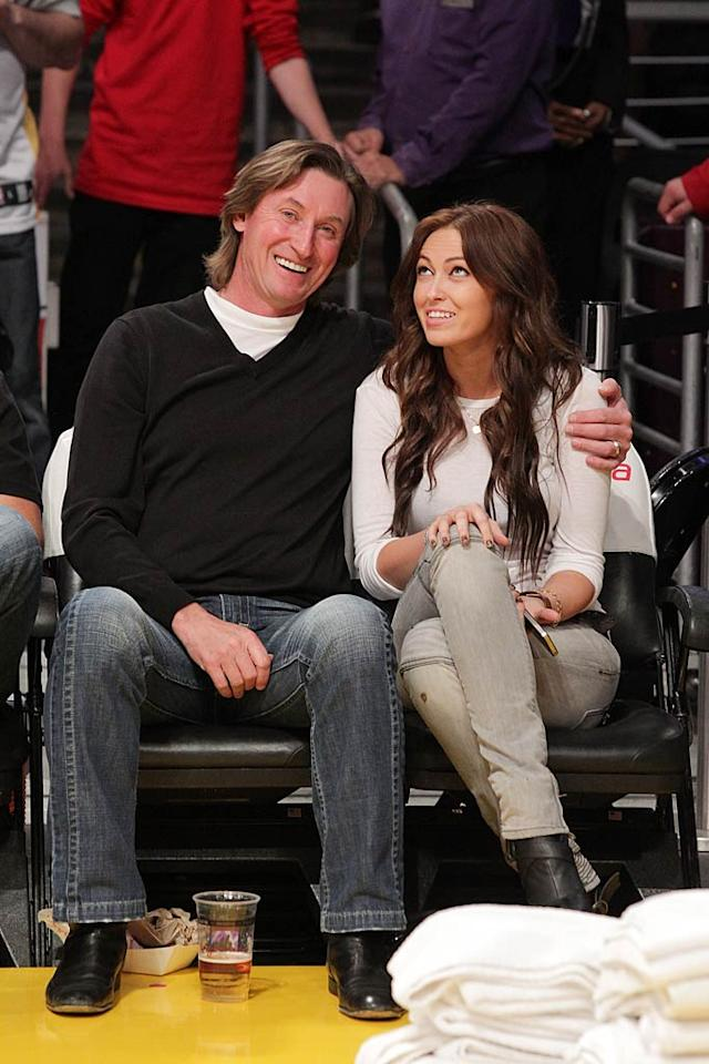 "Nope, that's not Wayne Gretzky's new girl -- it's his oldest child Paulina. The hockey great, who turns the big 5-0 today (January 26), has been married to Janet Jones of ""Dance Fever"" fame for 22 years! The couple has five kids in all. Noel Vasquez/<a href=""http://www.gettyimages.com/"" target=""new"">GettyImages.com</a> - January 25, 2011"
