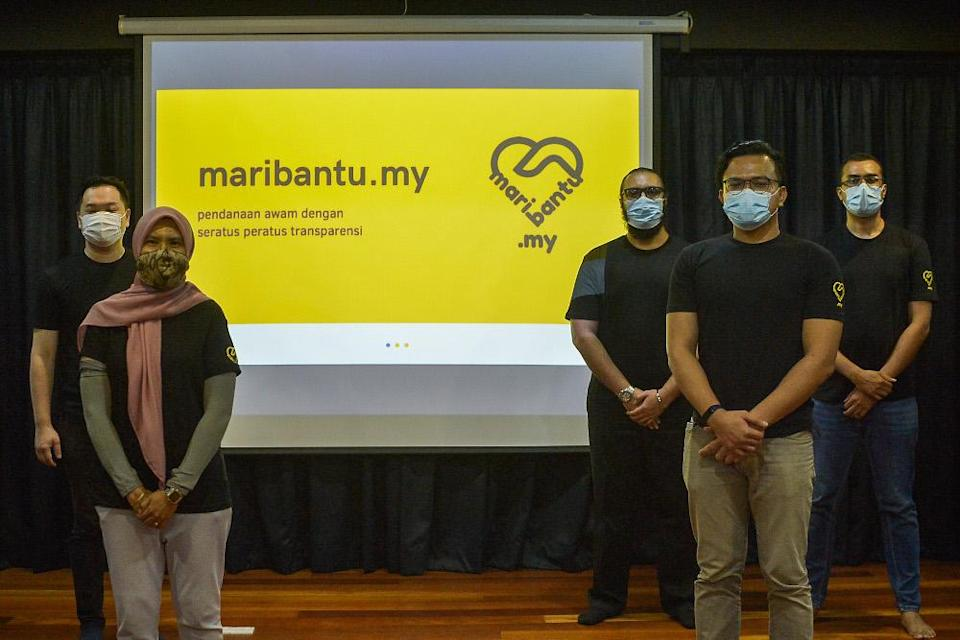 Muda members are seen during the launch of maribantu.my in Petaling Jaya on April 9, 2021. — Picture by Miera Zulyana