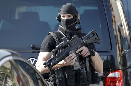 A member of special Police unit RAID outside the Tocqueville high school after a shooting incident injuring at least eight people, in Grasse, southern France, March 16, 2017.   REUTERS/Eric Gaillard