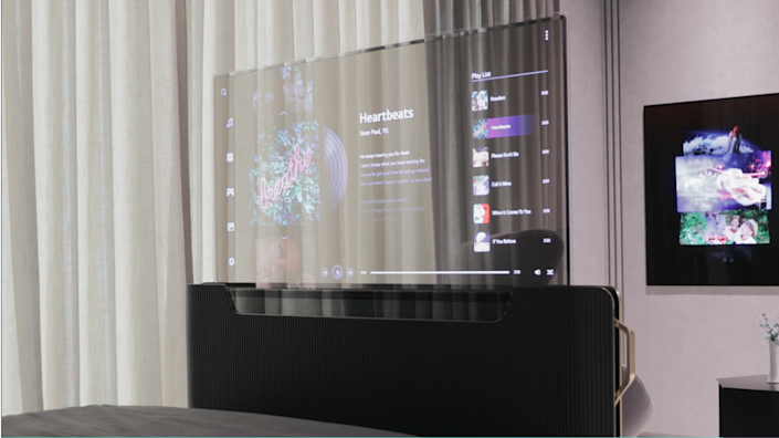LG Display showcased a futuristic TV concept that fuses a transparent screen and rollable OLED technology. It has residential and commercial applications.