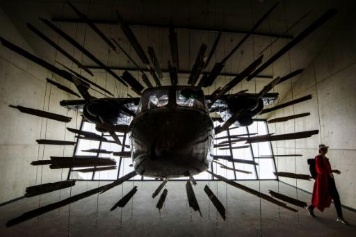 """A plane used in the Alpine chase sequence in the 007 movie """"Spectre"""" is on display at the James Bond cinematic installation in Austria"""