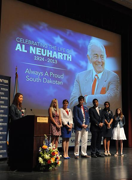 Al Neuharth's children and grandchildren: Karina Fornes-Neuharth, left to right; Alexis Fornes-Neuharth, Dani Keusch, AJ Keusch, Andre Fornes-Neuharth, Ariana Fornes-Neuharth and Rafi Fornes-Neuharth speak during a memorial service in honor of USA Today founder Al Neuharth at Aalfs Auditorium in Slagle Hall on the campus of the University of South Dakota in Vermillion, S.D., Friday, May 17, 2013. Neuharth died at his Cocoa Beach, Fla., home on April 19 at the age of 89. (AP Photo/Argus Leader, Jay Pickthorn)