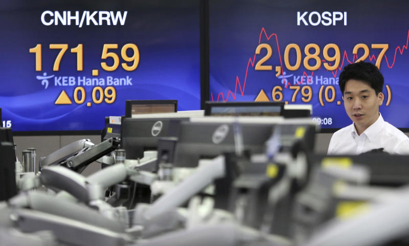 A currency trader watches monitors at the foreign exchange dealing room of the KEB Hana Bank headquarters in Seoul, South Korea, Tuesday, July 16, 2019. Asian shares were little changed and mixed in quiet trading Tuesday amid a lack of fresh market-moving news as investors looked ahead to earnings season. (AP Photo/Ahn Young-joon)