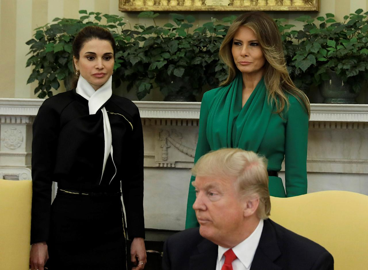 <p>U.S. first lady Melania Trump and Jordan's Queen Rania (L) look on as U.S. President Donald Trump meets with King Abdullah of Jordan (not pictured) at the White House in Washington, D.C. on April 5, 2017. (Photo: Kevin Lamarque/Reuters) </p>