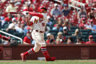 St. Louis Cardinals' Kolten Wong follows through on a two-run double during the eighth inning in the first baseball game of a doubleheader against the Cincinnati Reds, Saturday, Aug. 31, 2019, in St. Louis. (AP Photo/Jeff Roberson)