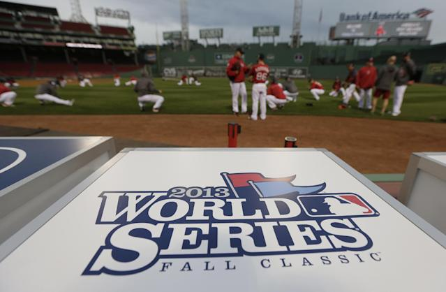Boston Red Sox players stretch before a workout at Fenway Park, Tuesday, Oct. 22, 2013, in Boston. The Red Sox are scheduled to host the St. Louis Cardinals in Game 1 of baseball's World Series on Wednesday.. (AP Photo/Charlie Riedel)