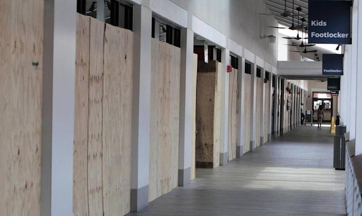 Miami, Florida, June 10, 2020- Kids Footlocker and Footlocker stores are boarded up after looting took place during the George Floyd protests in downtown Miami. Bayside was in the midst of a $27 million renovation to help its image stay with the times, but in mid-March, county and state officials shut down all nonessential businesses due to the Coronavirus pandemic. Bayside was also the target of looting amid the George Floyd protests; at least five stores, including Footlocker and Guess, saw property damage.