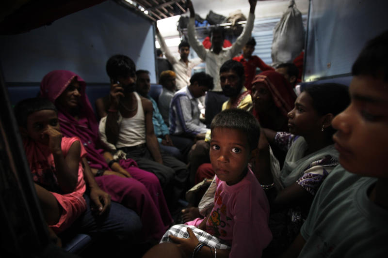 Passengers sit in a train and wait for power to get restored at a railway station in New Delhi, India, Monday, July 30, 2012.  A major power outage has struck northern India, plunging cities into darkness and stranding hundreds of thousands of commuters. (AP Photo/Rajesh Kumar Singh)