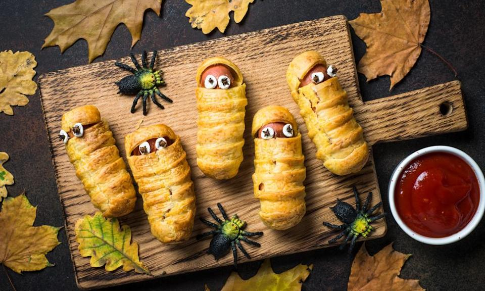 Scary sausage mummies wrapped in pastry bandages