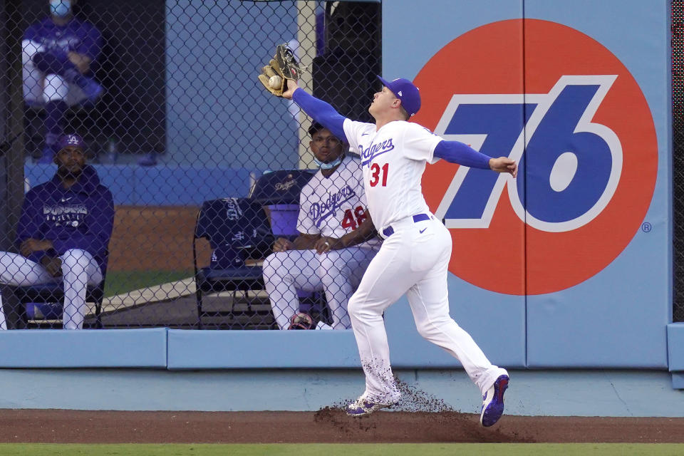Los Angeles Dodgers left fielder Joc Pederson makes a catch on a ball hit by San Diego Padres' Trent Grisham during the first inning of a baseball game Monday, Aug. 10, 2020, in Los Angeles. (AP Photo/Mark J. Terrill)
