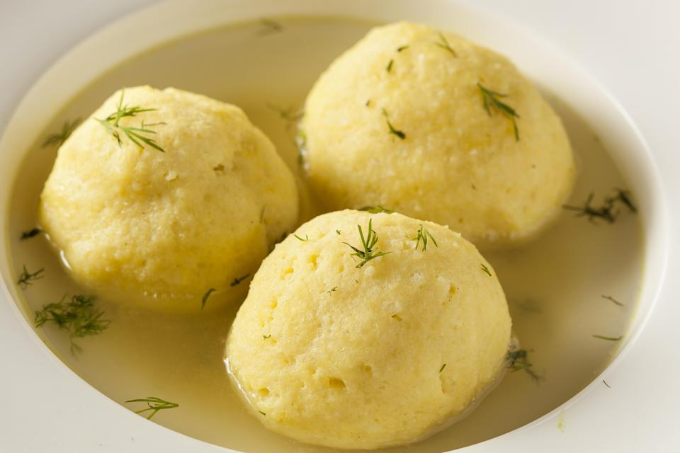"""<p>No seder is complete without a bowl of matzo ball soup. Though it's a comfort food year-round, Passover is its time to shine. This recipe is as traditional as they come but gives some must-know tips and tricks to make the best soup ever. It also offers advice for making and freezing all the components ahead of time.</p> <p><a href=""""https://www.thedailymeal.com/recipes/traditional-matzah-balls-recipe?referrer=yahoo&category=beauty_food&include_utm=1&utm_medium=referral&utm_source=yahoo&utm_campaign=feed"""" rel=""""nofollow noopener"""" target=""""_blank"""" data-ylk=""""slk:For the Traditional Matzo Balls recipe, click here."""" class=""""link rapid-noclick-resp"""">For the Traditional Matzo Balls recipe, click here.</a></p>"""