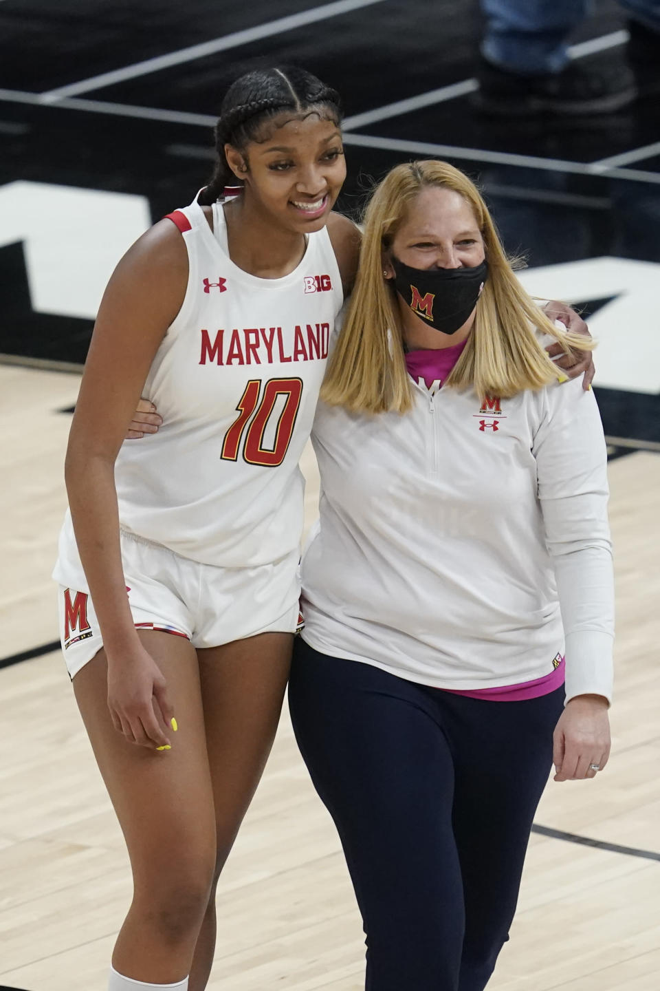 Maryland head coach Brenda Frese talks with Angel Reese following an NCAA college basketball semifinal game against Northwestern at the Big Ten Conference tournament, Friday, March 12, 2021, in Indianapolis. Maryland won 85-52. (AP Photo/Darron Cummings)