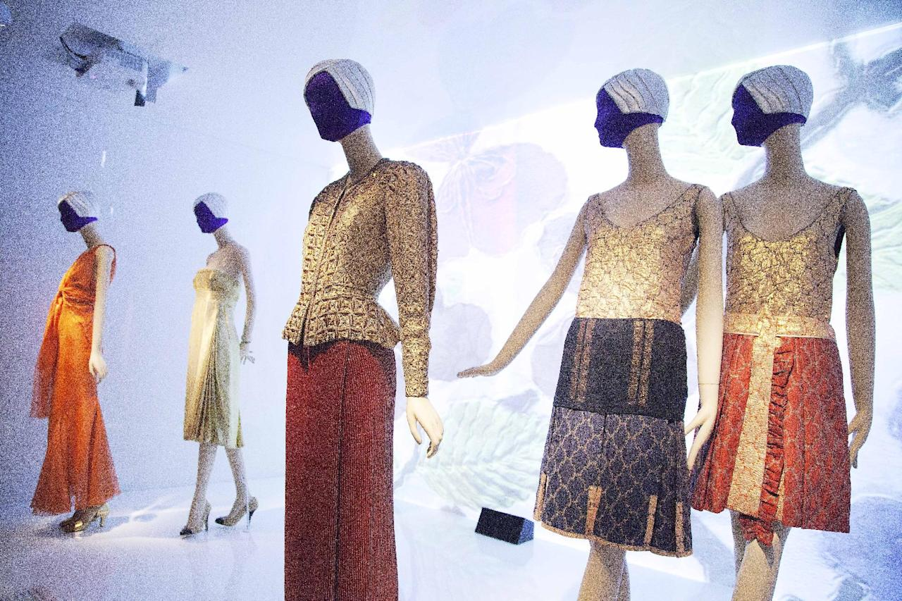 """Fashions by Miuccia Prada and Elsa Schiaparelli are on display at the Metropolitan Museum of Art, Monday, May 7, 2012 in New York. The show """"Schiaparelli and Prada, Impossible Conversations,"""" opens May 10 and continues through Aug. 19. (AP Photo/Mark Lennihan)"""