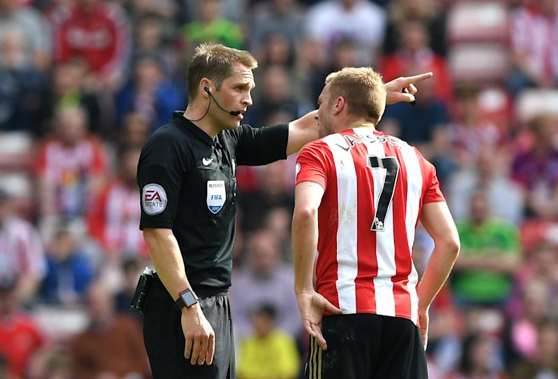 Craig Pawson shows Larsson where the showers are after his X-rated challenge