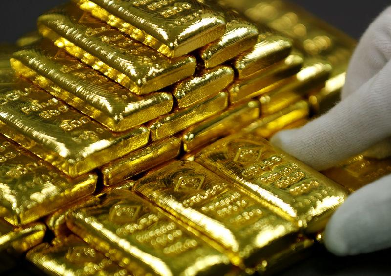 FILE PHOTO: An employee sorts gold bars in the Austrian Gold and Silver Separating Plant 'Oegussa' in Vienna