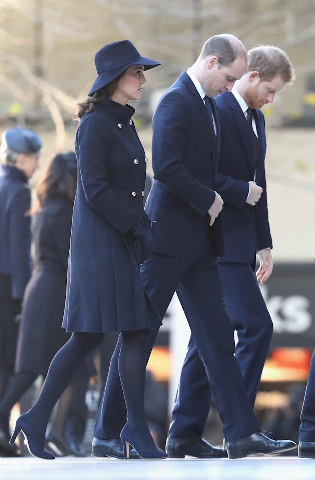 <p>Kate attended a memorial service for the victims of the Grenfell Tower fire wearing a suitably sombre look. The pregnant royal chose a £920 military-style navy coat by Carolina Herrera, suede navy heels and a matching floppy hat. <i>[Photo: Getty]</i> </p>