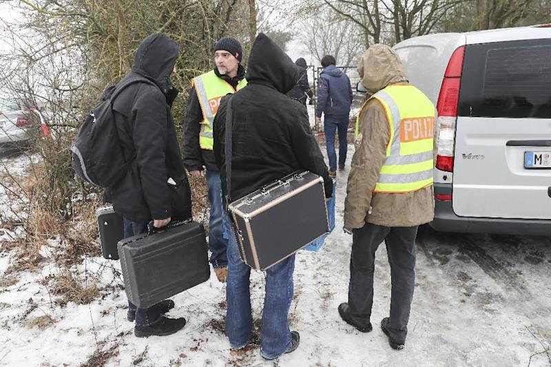FILE - In this Jan. 30, 2017 file photo police officers and forensics walk towards the private premises where the bodies of six teenagers were found near Arnstein, Germany. German investigators said six teenagers who died of carbon monoxide poisoning at a garden house in Bavaria had been using a gasoline-powered generator that wasn't authorized for indoor use. On Thursday, Feb. 2, 2017 Wuerzburg prosecutors and police said they had pinned down the generator as the source of the gas. (Daniel Karmann/dpa via AP,file)