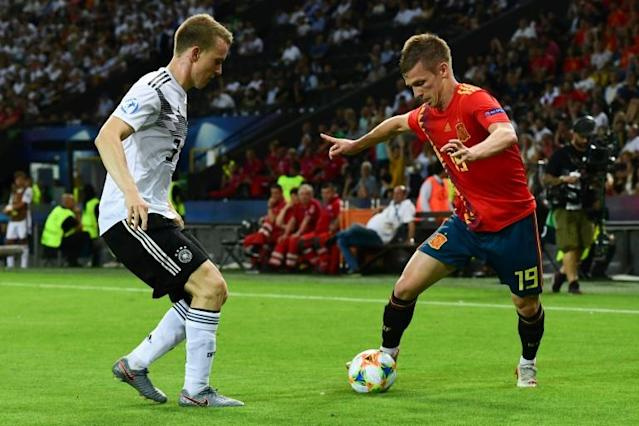 Spanish forward Dani Olmo (R), pictured in the U21 European Football Championships final against Germany last year (AFP Photo/Miguel MEDINA)