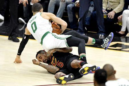 May 25, 2018; Cleveland, OH, USA; Boston Celtics forward Jayson Tatum (0) runs into Cleveland Cavaliers guard JR Smith (5) during the third quarter in game six of the Eastern conference finals of the 2018 NBA Playoffs at Quicken Loans Arena. Mandatory Credit: David Richard-USA TODAY Sports