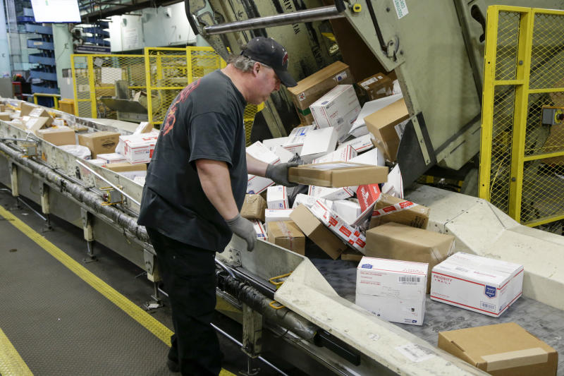 In this Thursday, Dec. 14, 2017 file photos, Steve Robino arranges packages on a conveyor belt at the main post office in Omaha, Neb. The US administration is threatening to pull the United States out of the 145-year-old Universal Postal Union, complaining that some postal carriers like China's aren't paying enough to have foreign shipments delivered on the final stretch to reach U.S. recipients. A special Universal Postal Union congress take place from Tuesday Sept. 24, to Thursday, Sept. 25, 2019 in Geneva Switzerland.(AP Photo/Nati Harnik)