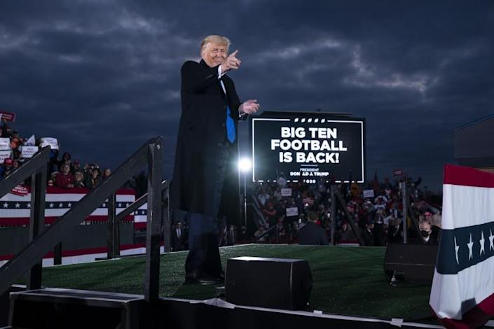 President Donald Trump points to the crowd after speaking during a campaign rally at Pickaway Agricultural and Event Center, Saturday, Oct. 24, 2020, in Circleville, Ohio. (AP Photo/Evan Vucci)