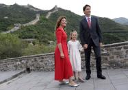 Prime Minister Justin Trudeau, his wife Sophie Gregoire, and daughter Ella-Grace pose for a photo atop a section of the Great Wall of China, in Beijing on Sept. 1, 2016. THE CANADIAN PRESS/Adrian Wyld