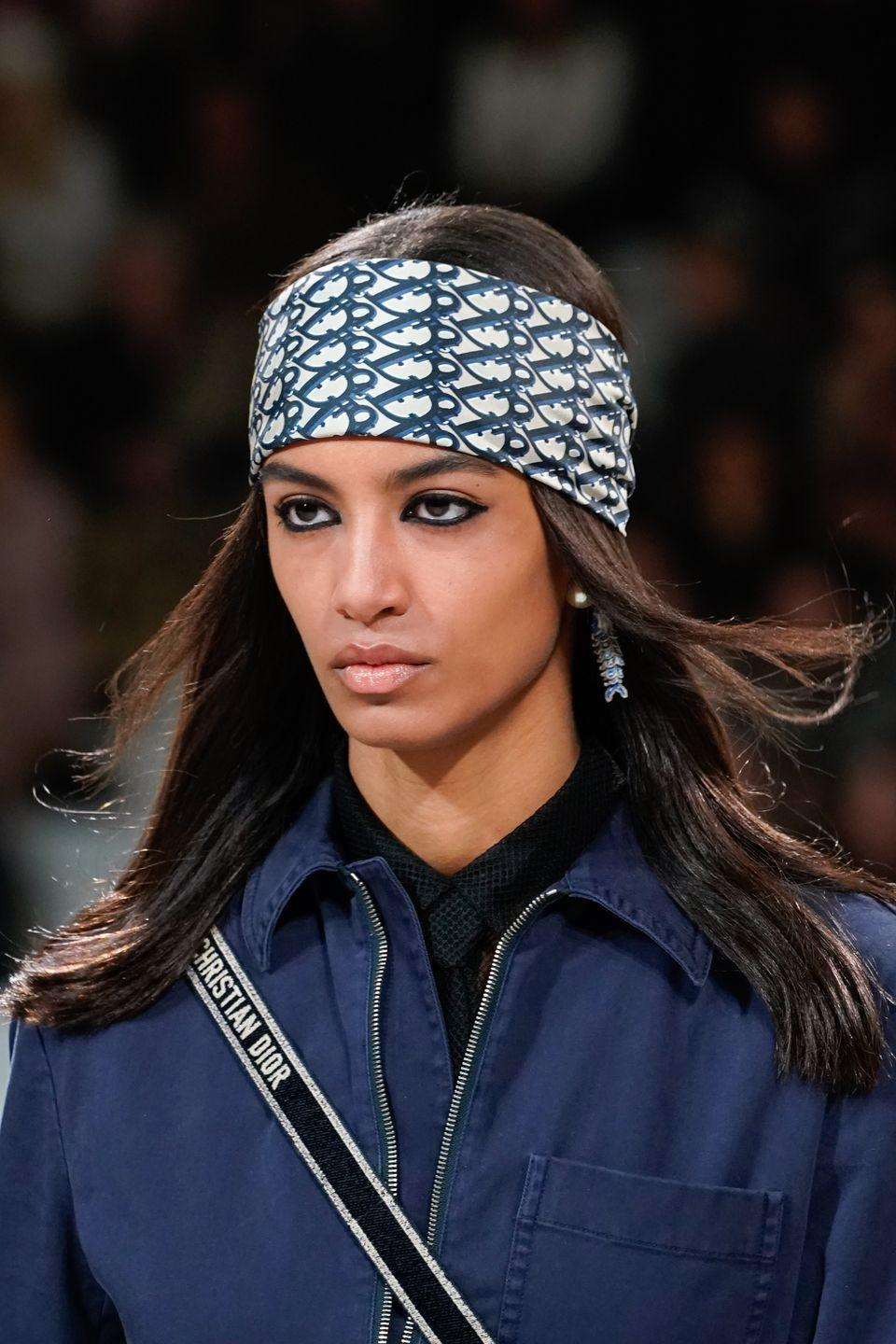 <p>Dior took the logo trend to the next level with pretty, printed silk bandanas. Try it next time you need to camouflage a bad hair day (or you run out of dry shampoo). </p>