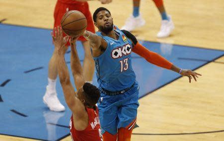Apr 19, 2019; Oklahoma City, OK, USA; Oklahoma City Thunder forward Paul George (13) and Portland Trail Blazers guard CJ McCollum (3) reach for a loose ball during the second half in game three of the first round of the 2019 NBA Playoffs at Chesapeake Energy Arena. Oklahoma City won 120-108. Mandatory Credit: Alonzo Adams-USA TODAY Sports