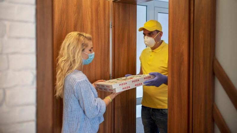 A man delivers pizza