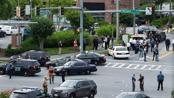 PHOTO: Maryland police officers block the intersection at the building entrance, after multiple people were shot at a newspaper in Annapolis, Md., June 28, 2018. (Jose Luis Magana/AP)