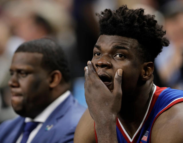 Kansas's Udoka Azubuike reacts on the bench during the second half in the semifinals of the Final Four NCAA college basketball tournament against Villanova, Saturday, March 31, 2018, in San Antonio. (AP Photo/Eric Gay)