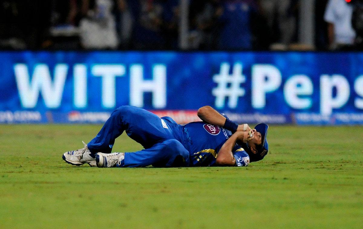 Sachin Tendulkar of Mumbai Indians lies down after finishing a catch to get the wicket of Praveen Kumar of Kings XI Punjab during match 41 of the Pepsi Indian Premier League ( IPL) 2013  between The Mumbai Indians and the Kings XI Punjab held at the Wankhede Stadium in Mumbai on the 29th April 2013 (BCCI)