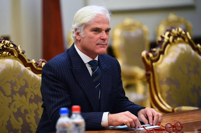 DUSHANBE, TAJIKISTAN - FEBRUARY 17: British Minister of State for International Development Desmond Swayne meets Tajikistan's President Emomali Rahmon (not seen) during his official visit in Dushanbe, Tajikistan on February 17, 2016. (Photo by Tajikistan Presidency Press Office/Anadolu Agency/Getty Images)