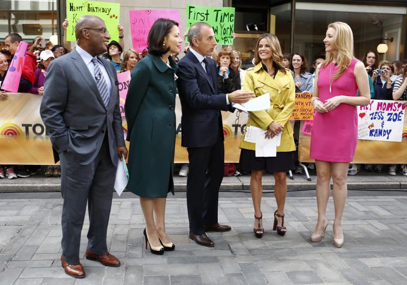 """This image released NBC, """"Today"""" show co-hosts, from left, Al Roker, Ann Curry, Matt Lauer, Natalie Morales talk with Lisa Kudrow on the """"Today"""" show, Tuesday, June 26, 2012 in New York. Curry got thumped by a """"Today"""" TV camera Tuesday, during a crowd-panning sequence out on Rockefeller Plaza. Curry's face collided with the camera lens on live TV. (AP Photo/NBC, Peter Kramer)"""