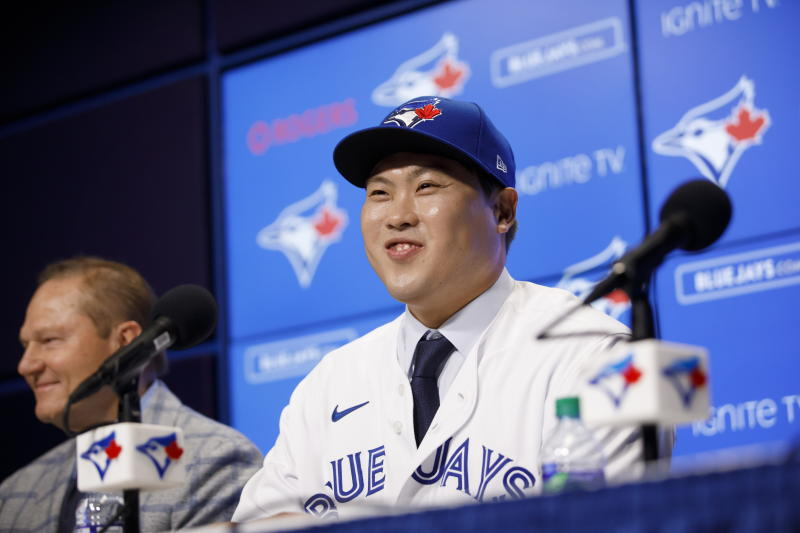 Toronto Blue Jays newly signed pitcher Hyun-Jin Ryu, right, smiles as he speaks to media at a news conference announcing his signing to the team in Toronto, Friday, Dec. 27, 2019. (Cole Burston/The Canadian Press via AP)