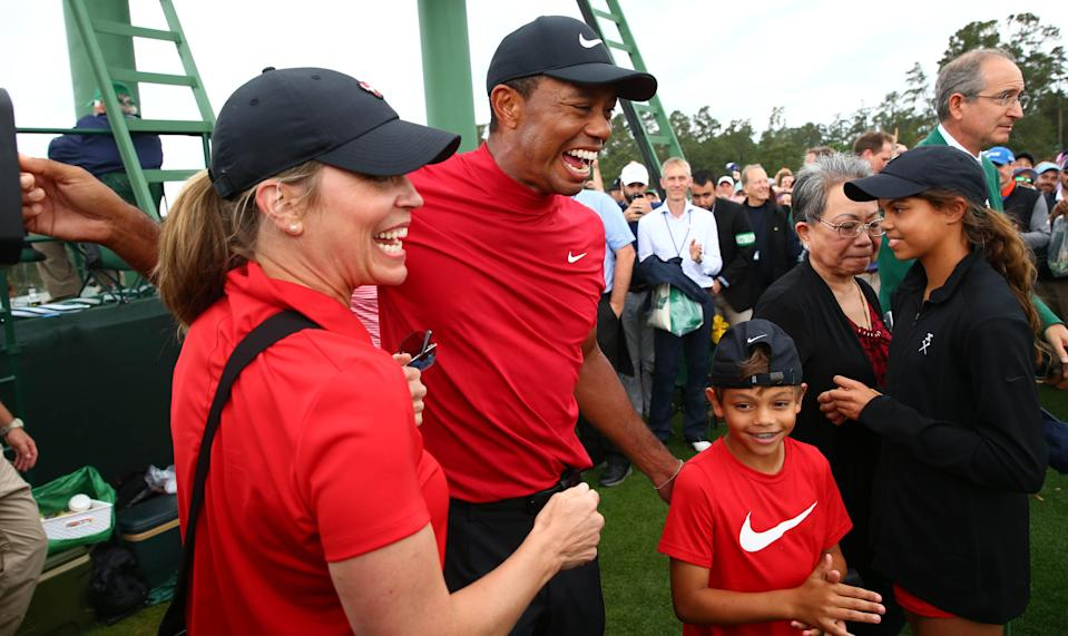 Apr 14, 2019; Augusta, GA, USA; Tiger Woods celebrates with daughter Sam and son Charlie after winning The Masters golf tournament at Augusta National Golf Club. Mandatory Credit: Rob Schumacher-USA TODAY Sports