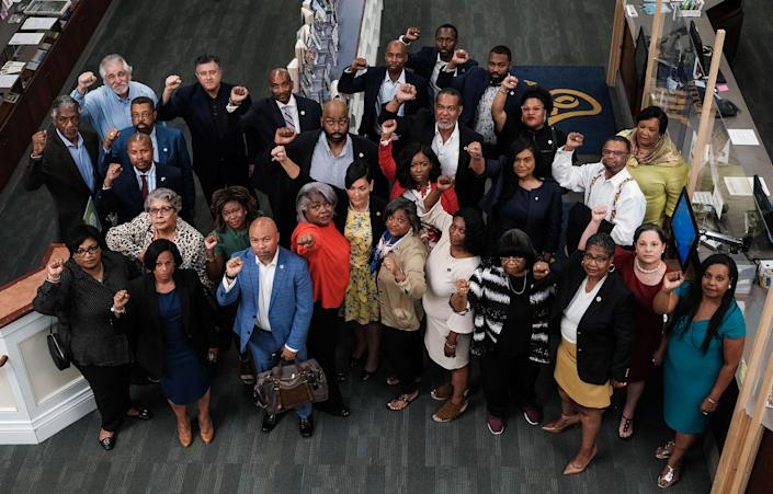 """Members of the Texas Legislative Black Caucus stand for a portrait at Kate Waller Barrett Branch Library in Alexandria, Va. on July 16.<span class=""""copyright"""">Michael A. McCoy for TIME</span>"""