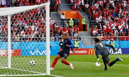 Soccer Football - World Cup - Group C - France vs Peru - Ekaterinburg Arena, Yekaterinburg, Russia - June 21, 2018 France's Kylian Mbappe scores their first goal REUTERS/Jason Cairnduff