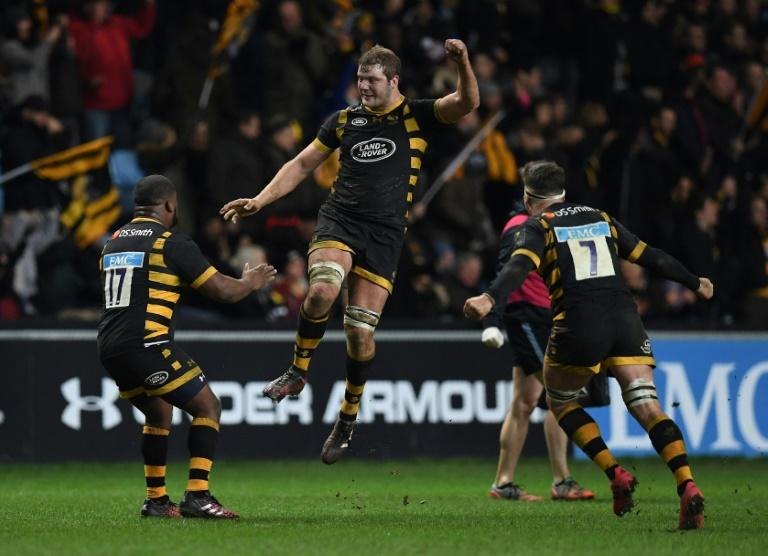 Wasps' players celebrate after winning a European Rugby Champions Cup rugby union match at The Ricoh Arena in Coventry, central England, in January 2017