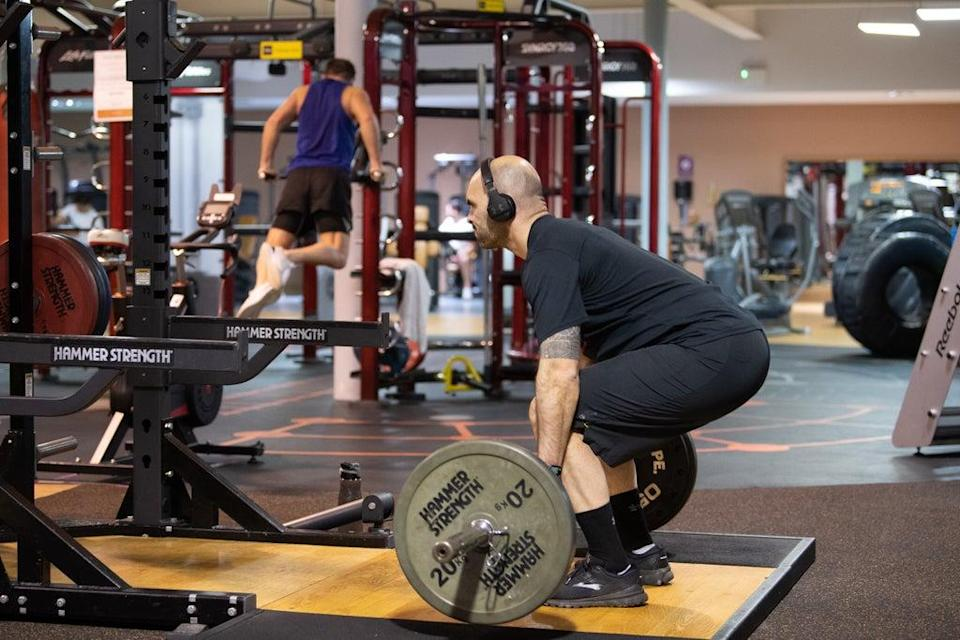 Gym members work out (PA Wire)
