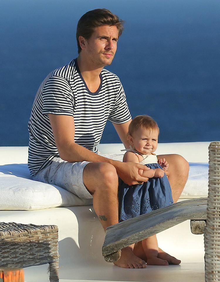 Kourtney Kardashian's boyfriend Scott Disick kept a hand on 9-month-old daughter Penelope's tiny little arm as the tot tried out standing on her own during a family vacation in Greece. Hey, you gotta' stand up in order to see those amazing ocean views! (5/1/2013)