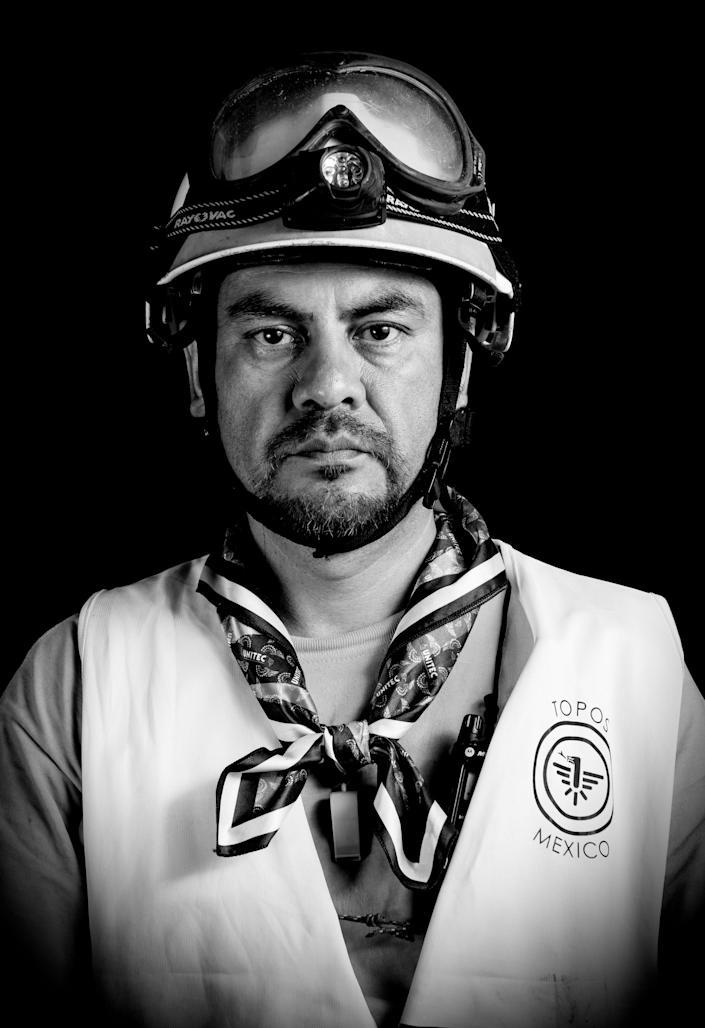 """<p>Ismael Villegas, an electric technician who volunteered as a """"topo"""" (mole) — as the diggers who burrow their way into collapsed buildings are known — after the 7.1 earthquake that hit Mexico on Sept. 19, poses for pictures in Mexico City on Sept. 25, 2017. What struck Villegas the most was that after many trips to help in other countries, he is now helping in his own. (Photo: Omar Torres/AFP/Getty Images) </p>"""