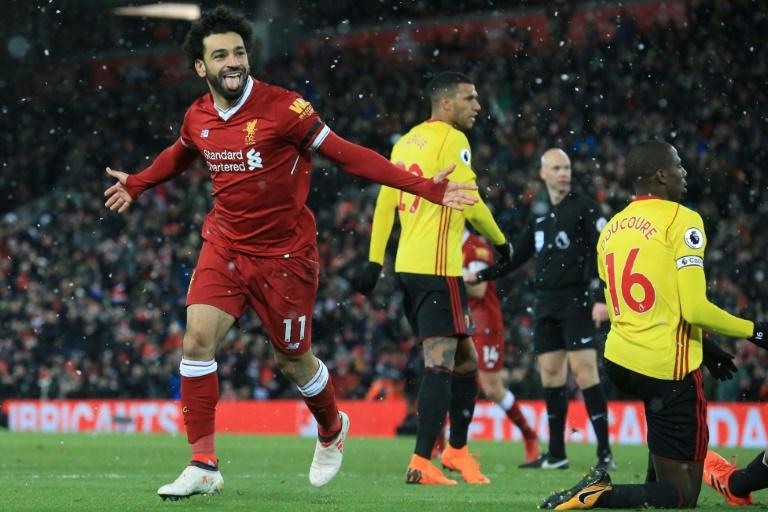 Mohamed Salah, 25, could become the world's top player succeeding Cristiano Ronaldo and Lionel Messi, both in their 30s, his manager Jurgen Klopp believes   celebrates scoring the team's fourth goal during the English Premier League football match between Liverpool and Watford at Anfield in Liverpool, north west England on March 17, 2018