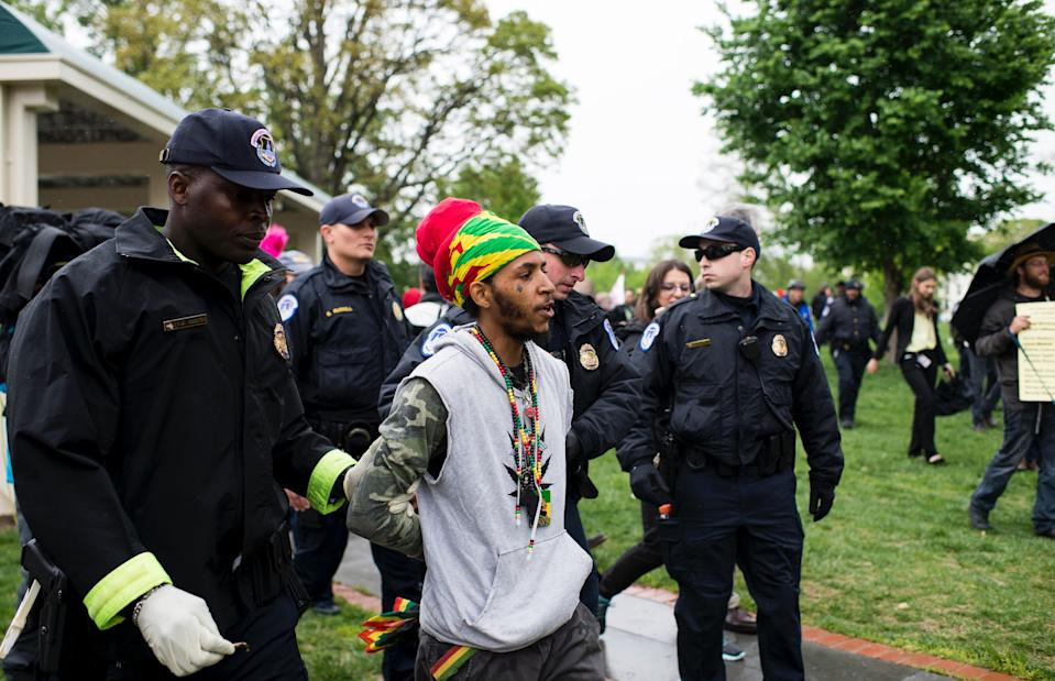 U.S. Capitol Police arrest several DCMJ.org marijuana advocates after they smoked marijuana in front of the U.S. Capitol during their protest on Monday, April 24, 2017. (Photo: Bill Clark/CQ Roll Call)