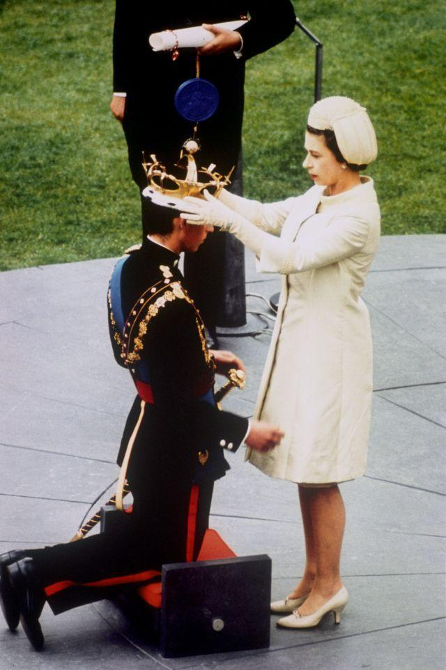 <p>The Queen crowns her son, Prince Charles, as the Prince of Wales, during an investiture ceremony at Caernarfon Castle. (PA Archive) </p>