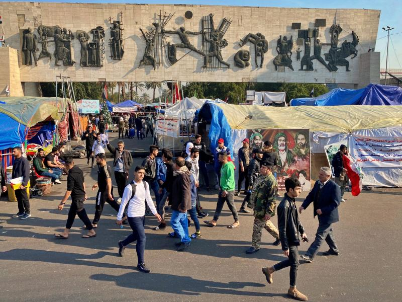 Anti-government protesters gather in Tahrir Square in Baghdad, Iraq, Sunday, Dec. 22, 2019. Thousands of protesters poured into the streets of Baghdad and Iraq's southern provinces on Sunday, rejecting the nomination of what some call an Iran-backed candidate for the prime minister's post. The demonstrations came as a midnight deadline loomed without a solution being reached to name an interim premier. (AP Photo/Khalid Mohammed)
