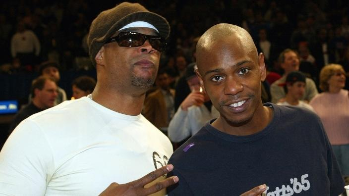 In this Feb. 2004 photo, comedians and friends Damon Wayans (left) and Dave Chappelle (right) hang out at the New York Knicks versus Cleveland Cavaliers NBA game at Madison Square Garden. (Photo: Ray Amati/Getty Images)