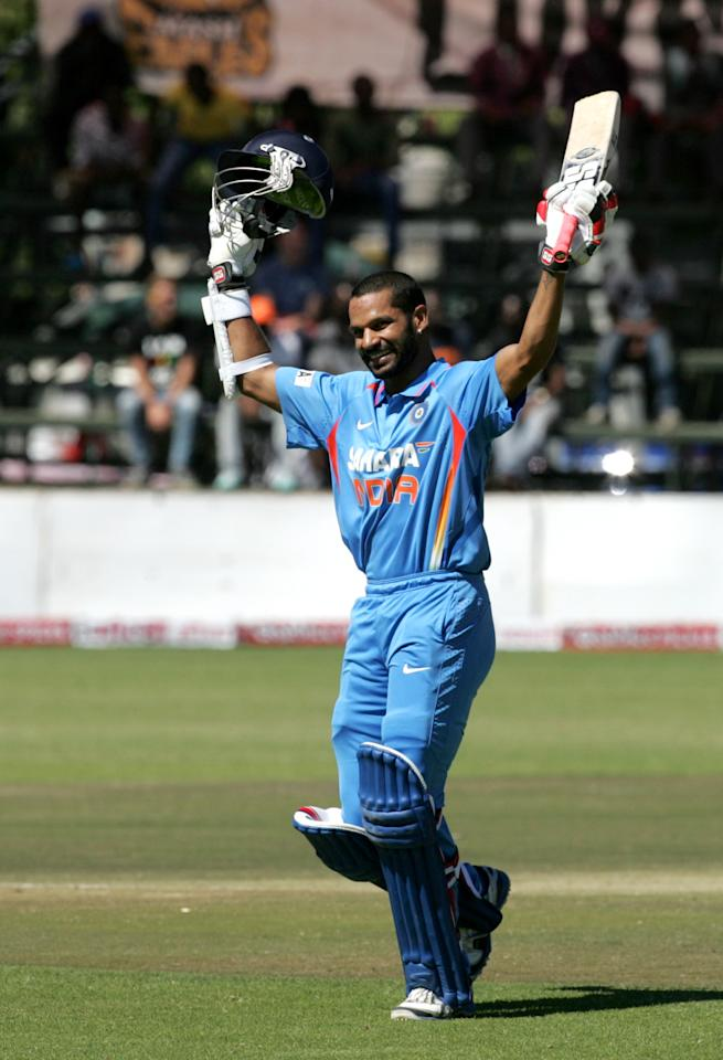 India batsman Shikhar Dhawan celebrates his century during the 2nd match of the 5 match cricket ODI series between hosts Zimbabwe and India at Harare Sports Club on July 2, 6 2013. AFP PHOTO /Jekesai Njikizana.        (Photo credit should read JEKESAI NJIKIZANA/AFP/Getty Images)