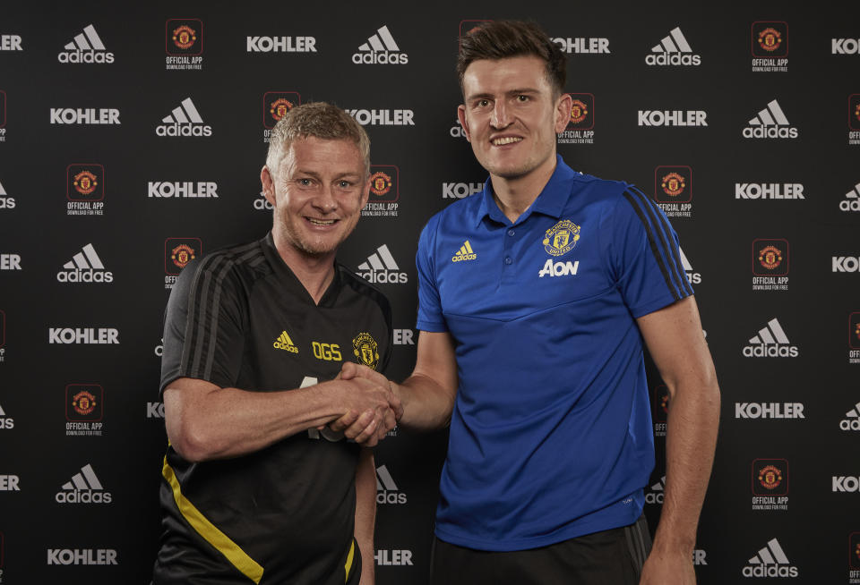 MANCHESTER, ENGLAND - AUGUST 04: (EXCLUSIVE COVERAGE) Harry Maguire of Manchester United poses with Manager Ole Gunnar Solskjaer after signing for the club at Aon Training Complex on August 04, 2019 in Manchester, England. (Photo by Manchester United/Manchester United via Getty Images)