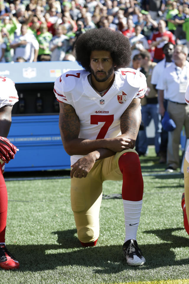 """FILE - In this Sept. 25, 2016, file photo, San Francisco 49ers' Colin Kaepernick kneels during the national anthem before an NFL football game against the Seattle Seahawks in Seattle. His peaceful demonstrations of kneeling during the national anthem were misconstrued by many as being un-American, as representing protests against the flag and """"The Star-Spangled Banner."""" While becoming a standard bearer _ even a hero _ for those facing such oppression, he became a pariah to NFL team owners. It has cost him three years of his football playing career. Prime years. (AP Photo/Ted S. Warren, File)"""